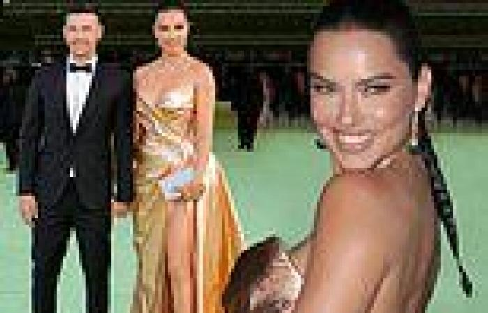 Adriana Lima glows in shoulder-less golden gown alongside beau Andre L III at ...
