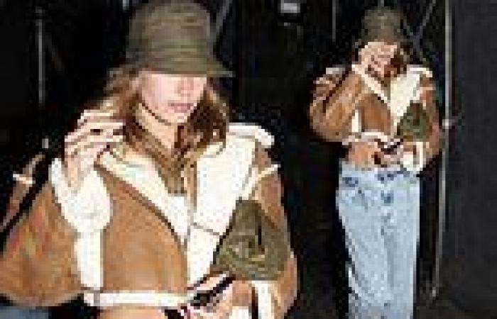Hailey Bieber flashes her toned tummy in a cropped sheepskin leather jacket ...