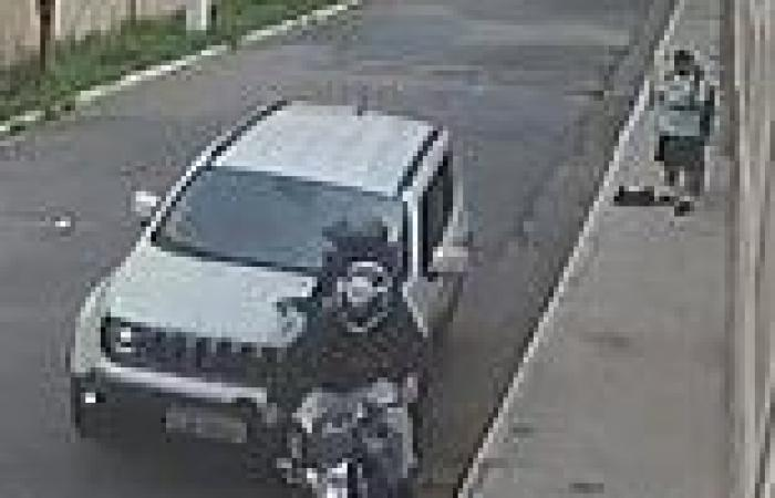 SUV driver rams motorbike robbers as they hold up couple on a street in Brazil