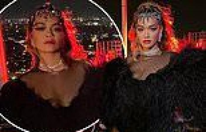 Rita Ora puts on a leggy display in a sheer feathered bodysuit