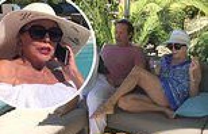 Joan Collins, 88, wows fans as she shows off her pins while relaxing with ...