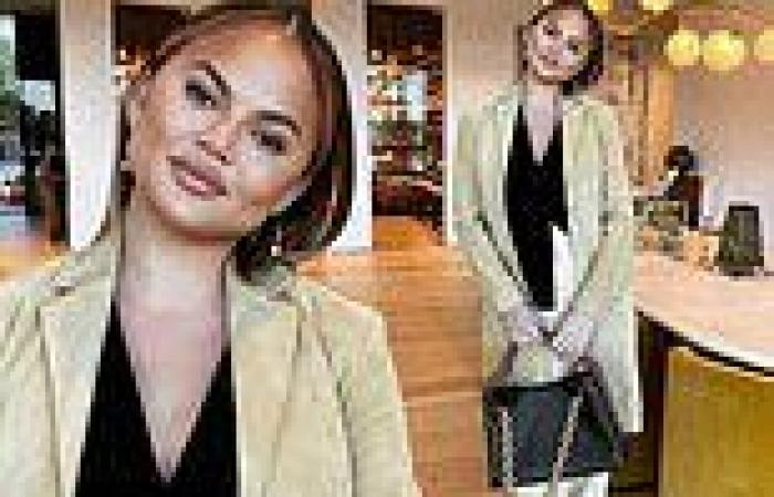 Chrissy Teigen shows off the business chic look she wore to the courthouse for ...