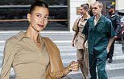 Justin Bieber and wife Hailey both wear khaki as they walk hand-in-hand on ...