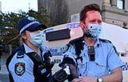 Coronavirus Australia: Officer splattered with ink by protestors later shakes ...
