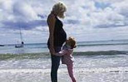 Helen George shows off her blossoming bump on the beach with daughter Wren
